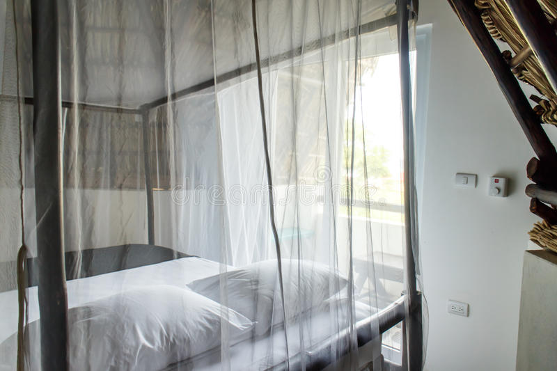 Bedroom with mosquito net, holiday. Bedroom with mosquito net indoors stock image