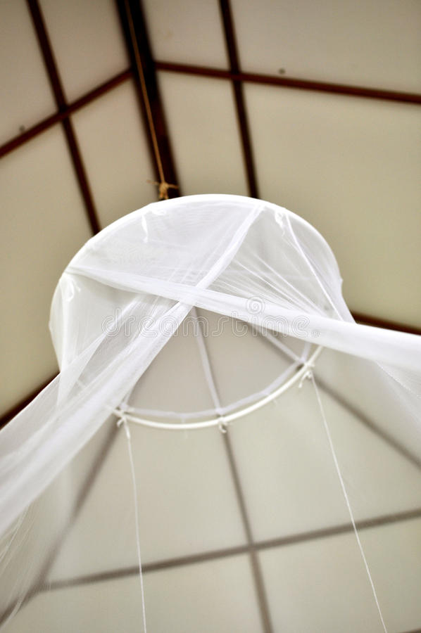 Bedroom mosquito net stock photography