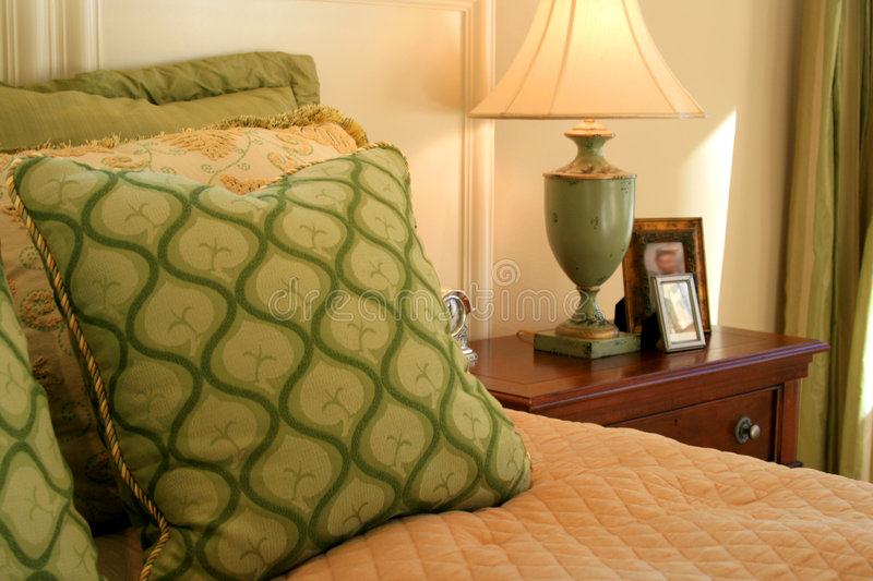 Bedroom, Pillows, Lamp,Table stock photography