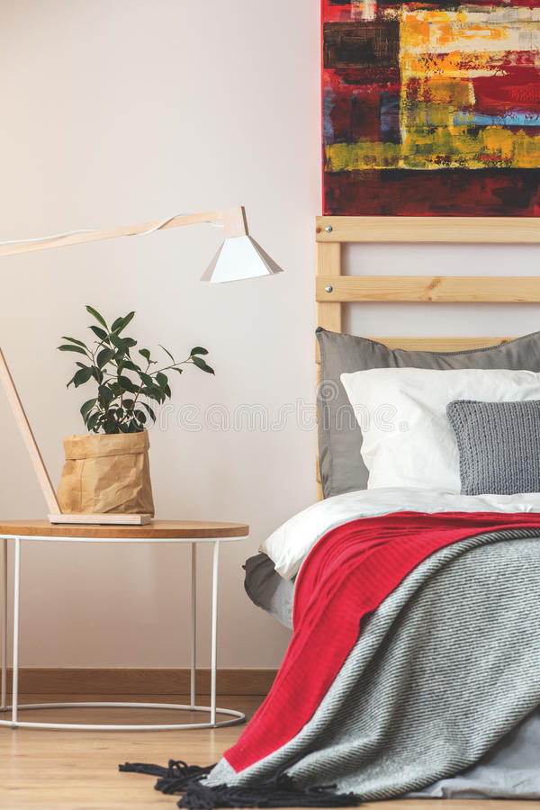 Bedroom with plant, lamp and painting stock photo