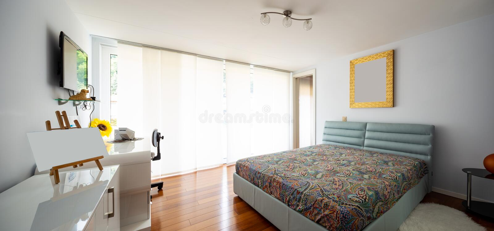Bedroom with private bathroom in the room. Nobody inside royalty free stock photo