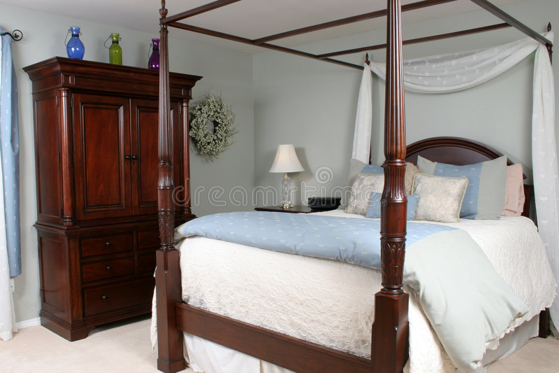 Bedroom Retreat. A beautifully decorated bedroom done in soft colors stock photo