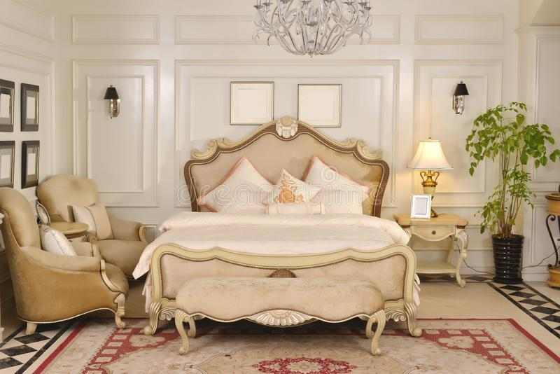 Bedroom room furniture in luxury house. Classical luxury bedroom furniture in house , bedchamber, chair, blank photo frame,cabinet, bed lamp,bedding pillow royalty free stock photos