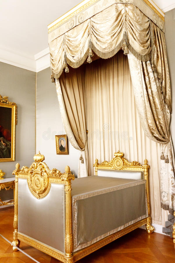 Bedroom with royal canopy bed. Golden royal canopy bed and bedroom, Munich, Germany stock photography