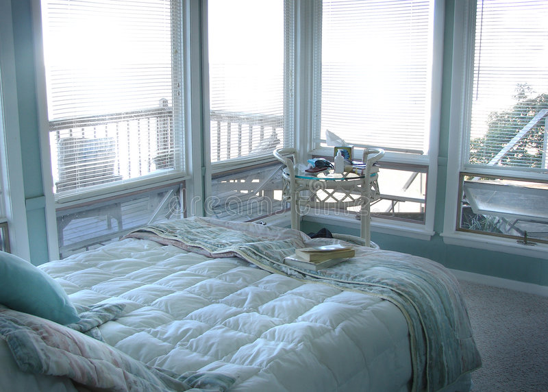 Bedroom by the sea royalty free stock photography