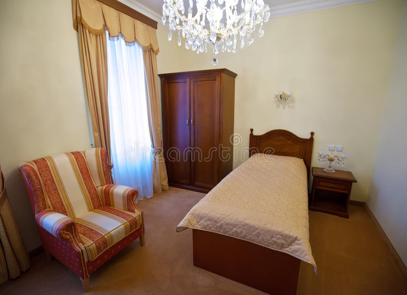 Bedroom with single bed royalty free stock photography