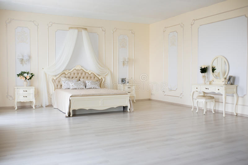 Download Bedroom In Soft Light Colors Big Comfortable Double Bed Elegant Classic Interior Stock