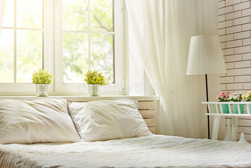 Bedroom in soft light colors royalty free stock photography