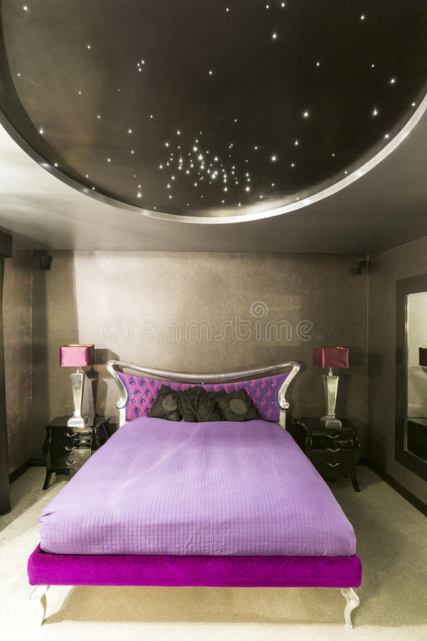 Bedroom with stars on the roof royalty free stock photography