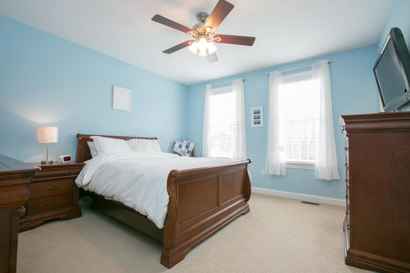 Bedroom. Stock comfortable bedroom interior bright lighting and fan royalty free stock photos