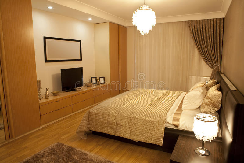 Bedroom suite. Modern bedroom. Bedroom suite and mirror detail stock image