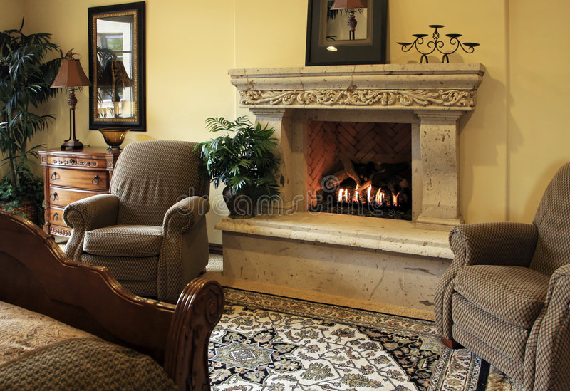 Bedroom suite with fireplace royalty free stock image