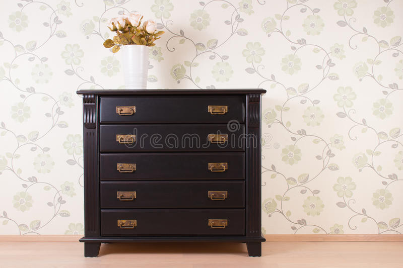 Bedroom wall with classic furniture. And roses royalty free stock image