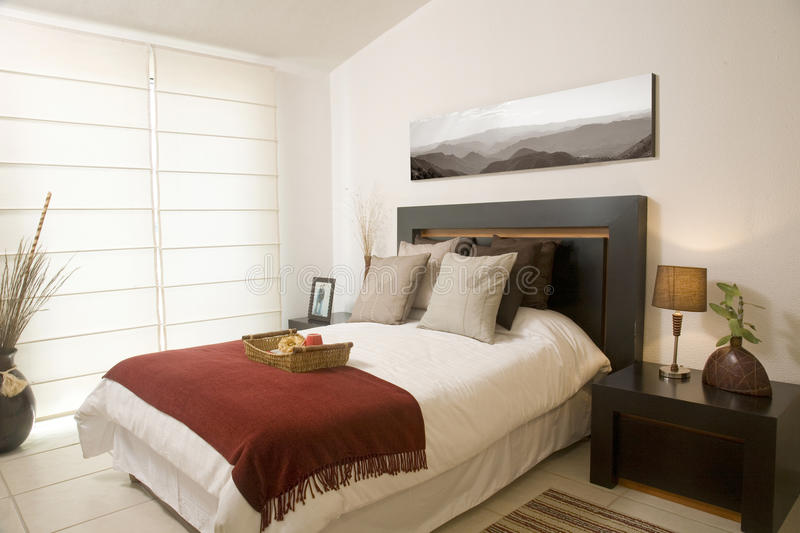 Bedroom. On warm colors with service in bed royalty free stock images