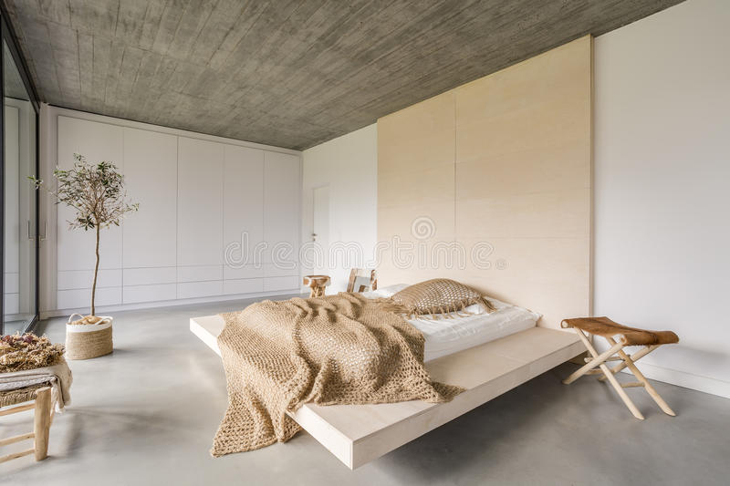 Bedroom with wooden ceiling royalty free stock image