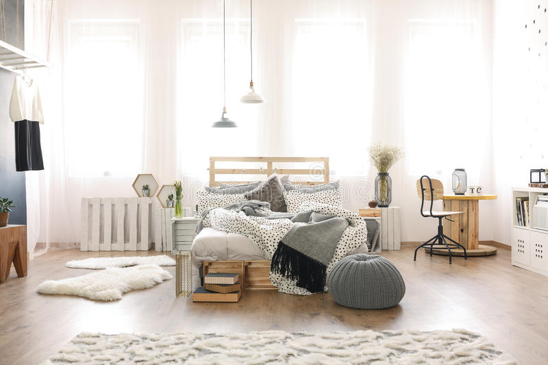Bedroom with wooden furniture. Modern spacious bedroom with wooden furniture stock images