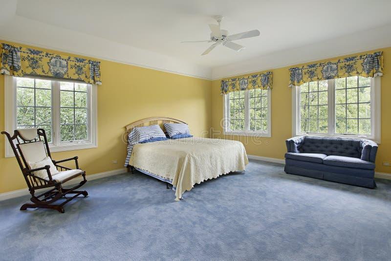 Bedroom with yellow walls stock photo. Image of upscale - 15990294