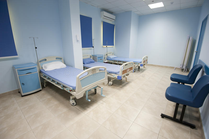 Beds in a hospital ward. Beds in a small hospital ward room stock photo