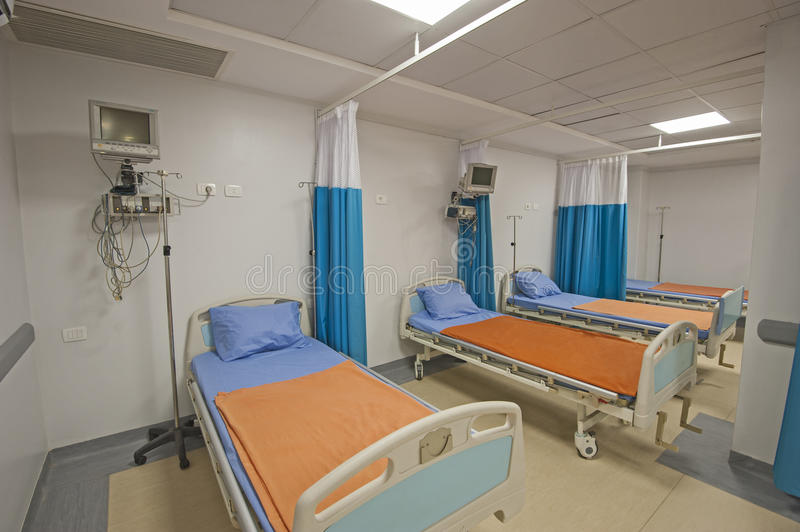 Beds in a hospital ward. Hospital beds in a private hospital intensive care ward with monitoring equipment stock photography