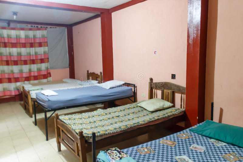 Beds in a hostel room from Nicaragua. Backpacker hostel room with prepared beds royalty free stock photography