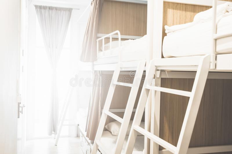 Beds inside the hostel room for tourists or the students blurred for background banner stock photo