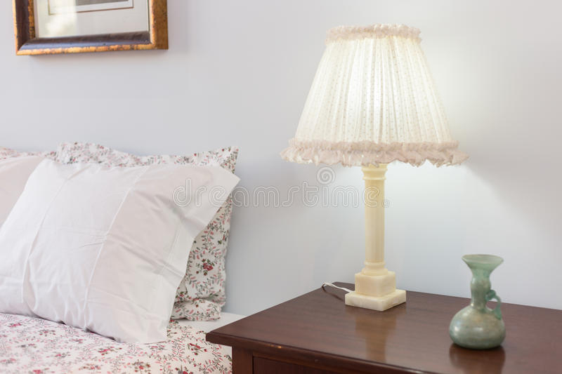 Bedside Table with Lamp. Bedside Table with Classic Lamp stock photography