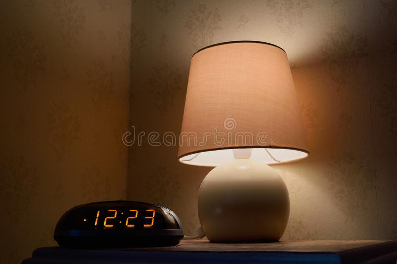 Bedside table. With lamp and clock royalty free stock photos