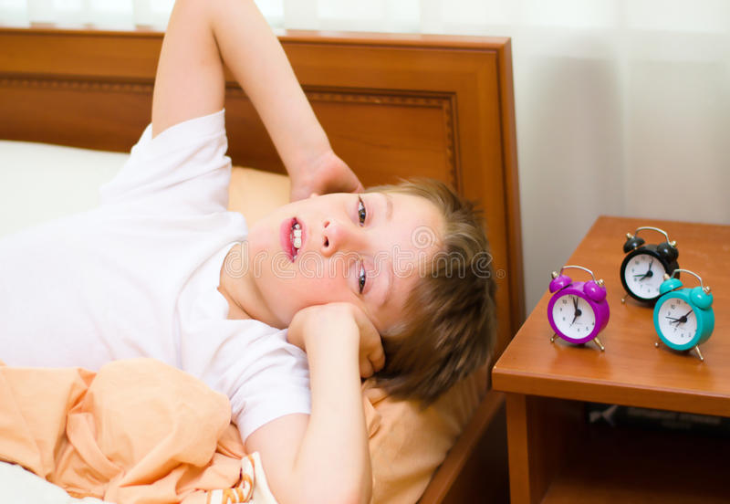 Bedtime For Little Schoolboy Royalty Free Stock Photos