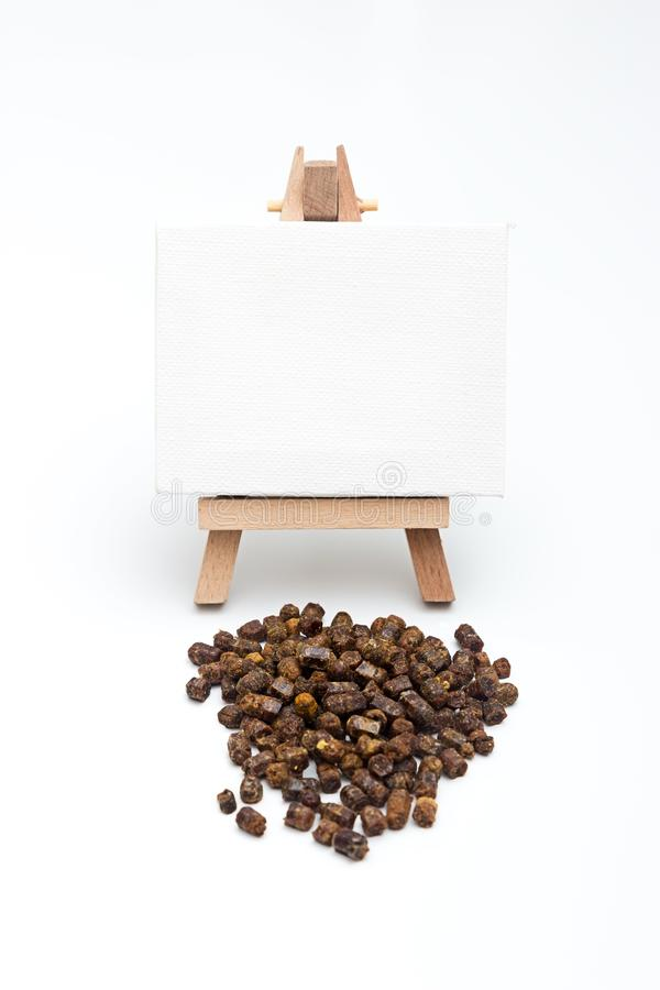 Bee bread, Perga with an easel. Bee bread, Perga on a white background with an easel for copy space stock photos