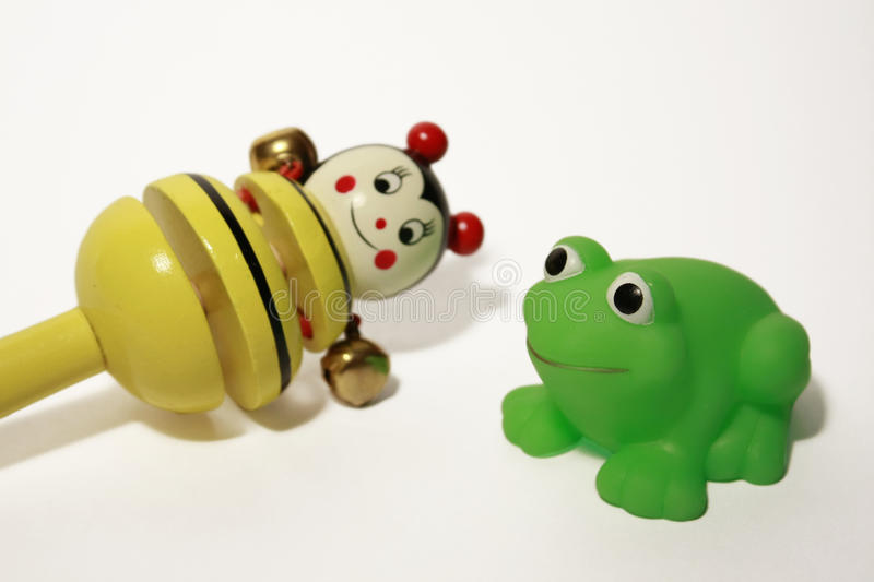 Bee and frog. Wooden bee and rubber frog for babies stock image