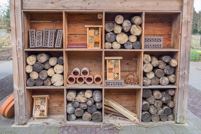 Bee house. With chopped wood storage and bricks royalty free stock images