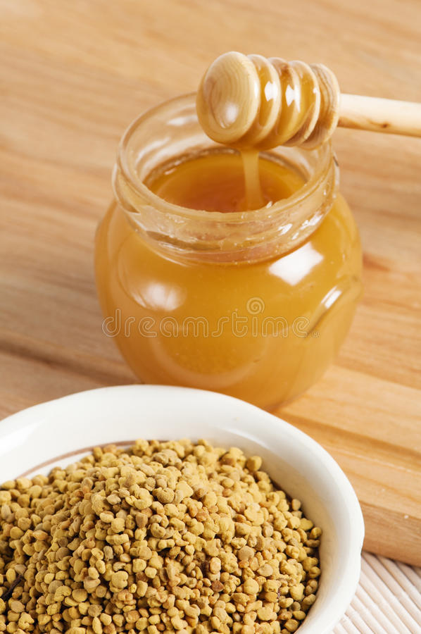 Bee pollen, close up. Bee pollen and honey, close up royalty free stock photo