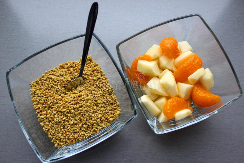 Bee pollen and fruit salad stock images