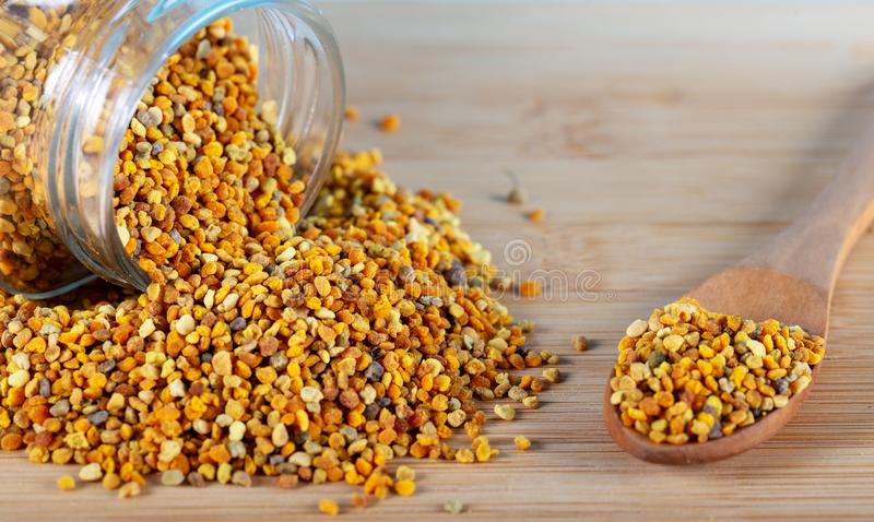 Bee pollen grains. And honey in bowl on a white background stock images