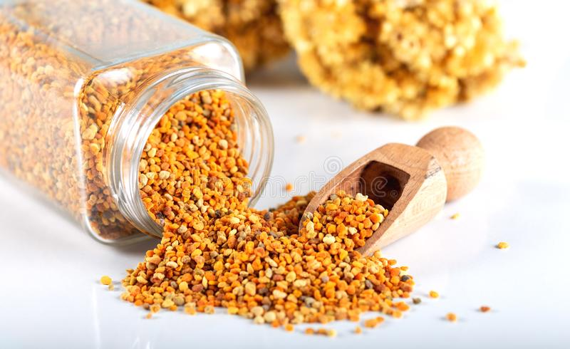 Bee pollen grains and honey in bowl. royalty free stock photography