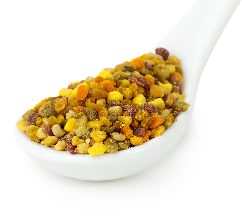 Bee pollen in spoon isolated on the white background.  royalty free stock photography