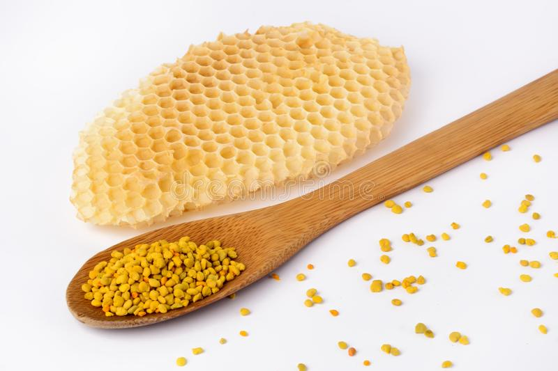 Bee pollen in a wooden spoon and a honeycomb. Beekeeping products. Apitherapy. royalty free stock images