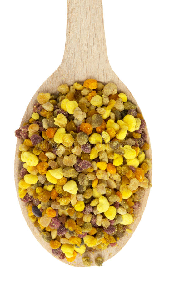 Bee pollen in wooden spoon isolated on the white background stock images