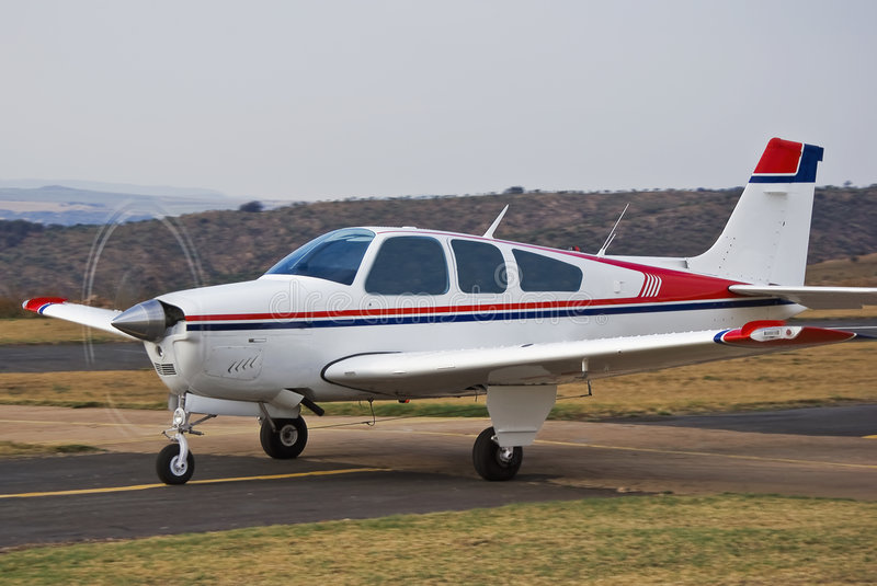 Beechcraft Bonanza. Ready, Steady, Fly … This light aircraft [Beechcraft Bonanza] is taxiing down the runway to get airborne stock photo