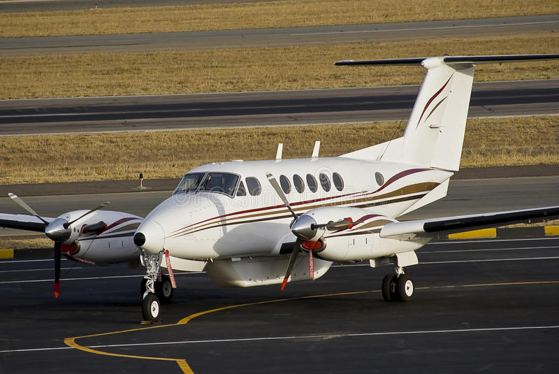 Beechcraft Super King Air B 200. Parked on the apron at Lanseria International Airport — South Africa — FALA. This one has what seems to be an royalty free stock image