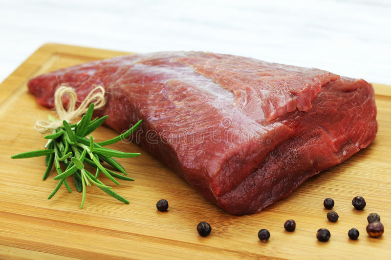 Beef. On the backing with herbs stock images