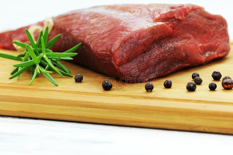 Beef. On the backing with herbs stock image