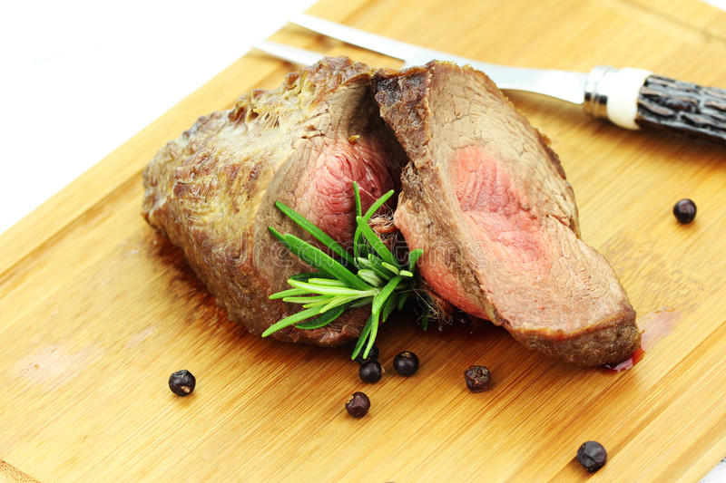 Beef. On the backing with herbs royalty free stock photos