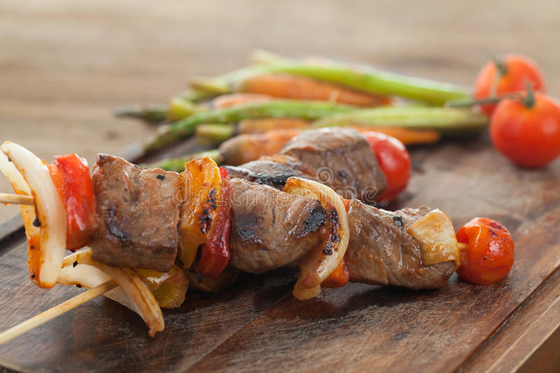 Beef barbecue on wood. In close up stock photo