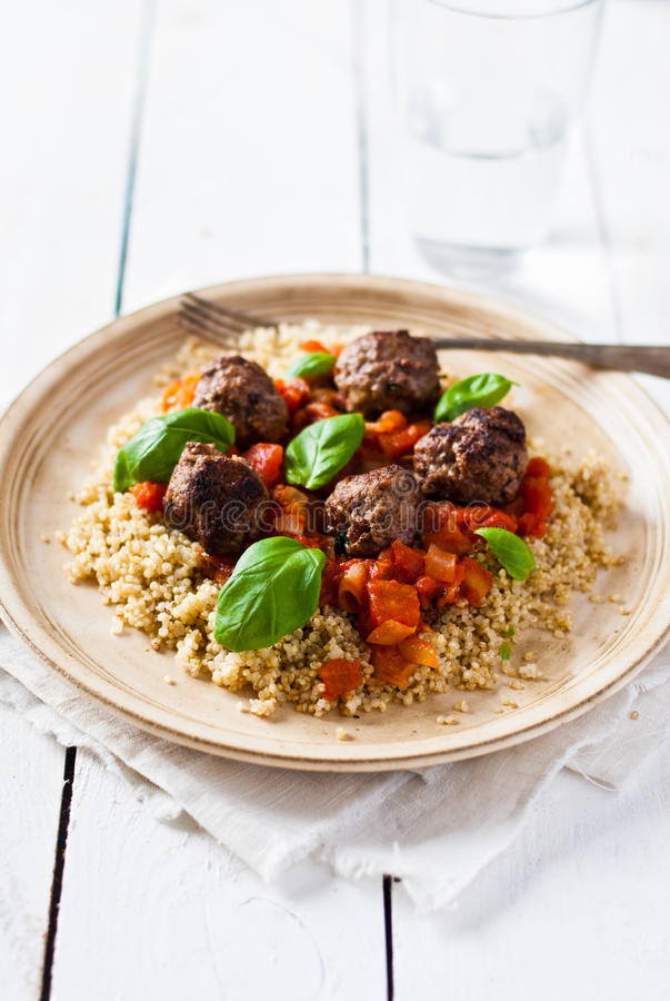 Beef, basil and tomato meatballs with quinoa stock photography