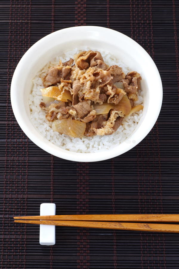 Beef bowl. Japanese dish consisting of a bowl of rice topped with beef and onion stock photo
