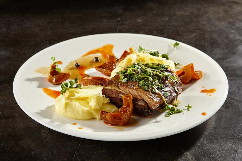 Beef brisket and mashed potato on white plate royalty free stock images