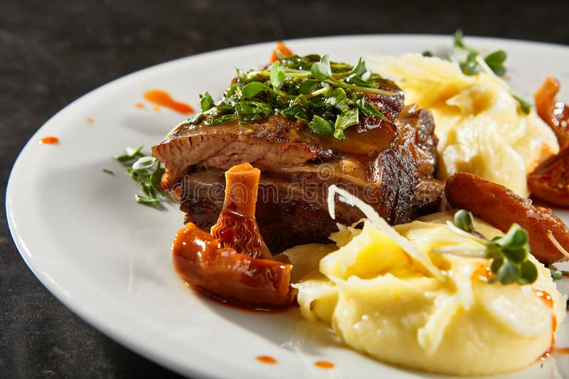 Beef brisket and mashed potato on white plate stock images