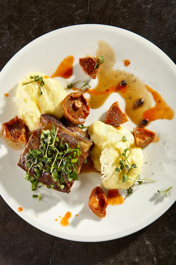 Beef brisket and mashed potato on white plate royalty free stock photography