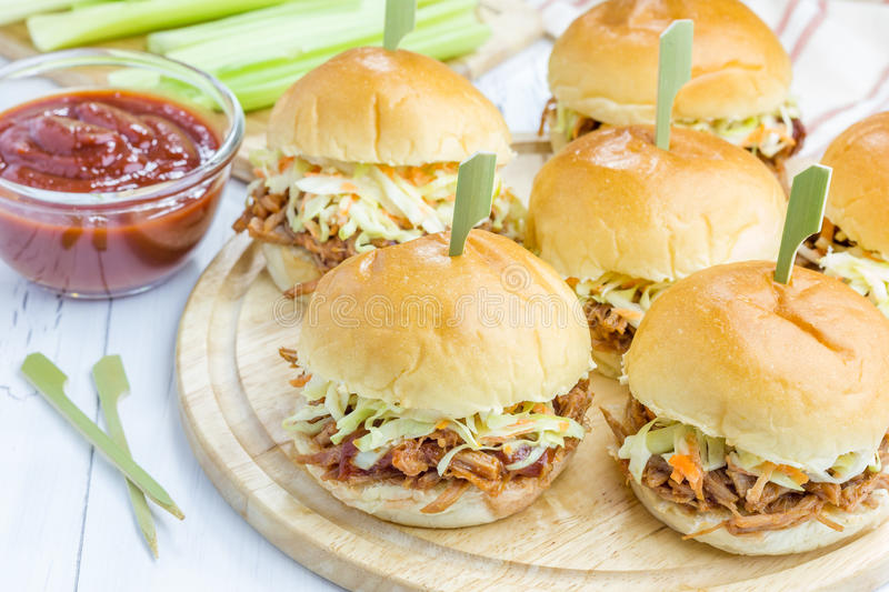 Beef brisket sliders. On a wooden board stock photos